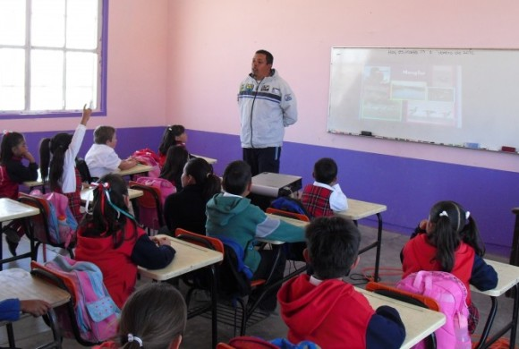 Researcher giving a presentation at school