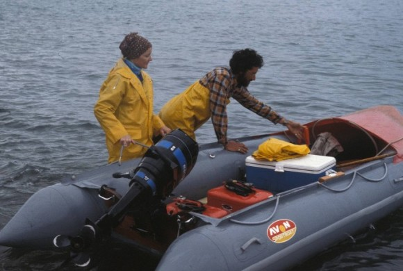 man and woman getting into boat