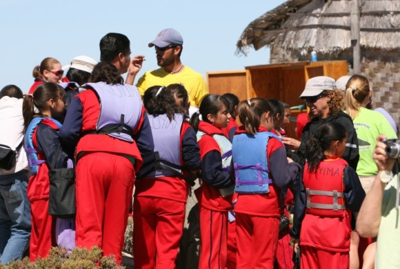 Students in life jackets prepare for outing